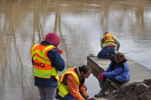 North Carolina Division of Water Quality Employees taking reference water samples upstream of the spill.  (Photo Eric Chance)